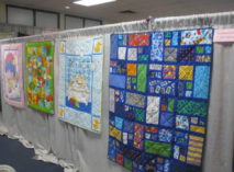 Community quilts in the tea room