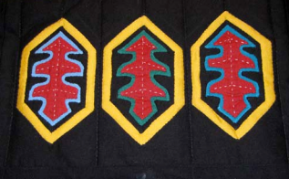 A completed variation with embroidery in the centre of each feather