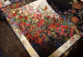 Just one of the many colour wash quilts that included flower garden Canadian flags that would be perfect for Canada's 150th birthday next year
