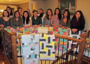 Burnaby Girls U17 Soccer Team with quilts donated by Lions Gate members